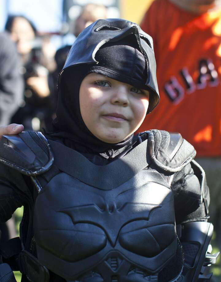 Leukemia survivor Miles, 5, dressed as BatKid, visits AT&T Park as part of a Make-A-Wish foundation fulfillment November 15, 2013 in San Francisco. The Make-A-Wish Greater Bay Area foundation turned the city into Gotham City for Miles by creating a day-long event bringing his wish to be BatKid to life.  Photo: Ramin Talaie, Getty Images