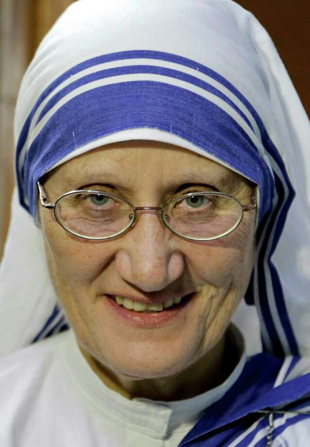 Sister Mary Prema, Superior General, Missionaries of Charity, the order founded by Mother Teresa, smiles as she talks to the media in Kolkata, India, Tuesday, March 15, 2016. Mother Teresa will be made a saint on Sept. 4. Pope Francis set the canonization date Tuesday, paving the way for the nun who cared for the poorest of the poor to become the centerpiece of his yearlong focus on the Catholic Church's merciful side. (AP Photo/ Bikas Das) Photo: Bikas Das, STR / AP