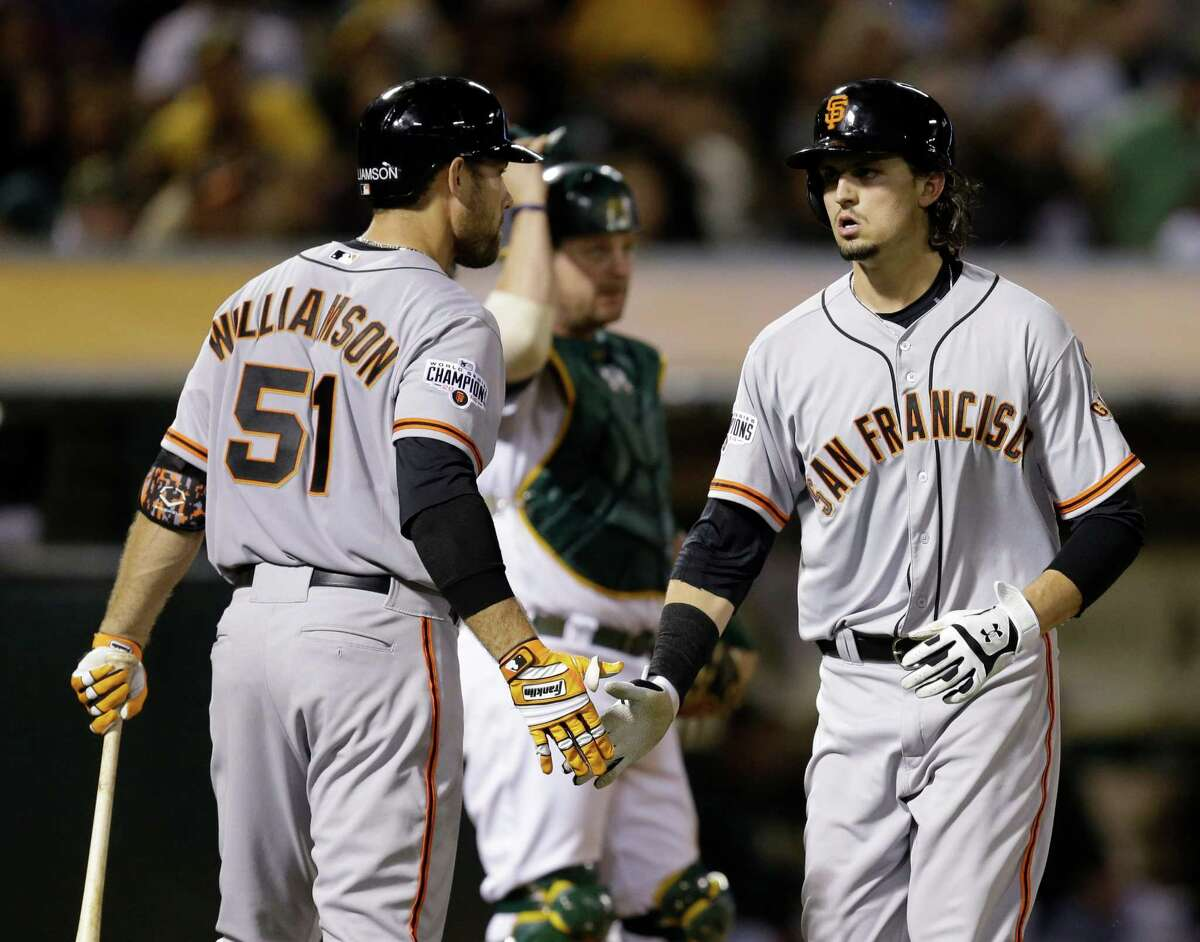 The Giants' Jarrett Parker (rght) is congratulated by Mac Williamson after hitting a home run against the A's on Sept. 25, 2015.