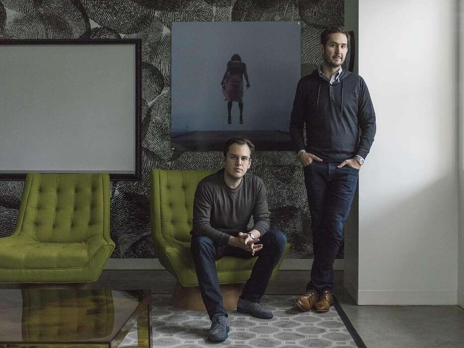 Mike Krieger, left, and Kevin Systrom, the co-founders of Instagram, on the Facebook campus in Menlo Park, Calif. Instagram plans to follow in the footsteps of Facebook and Twitter by shifting from displaying posts in strictly reverse-chronological order to ordering them algorithmically. (Jason Henry/The New York Times) Photo: JASON HENRY, NYT
