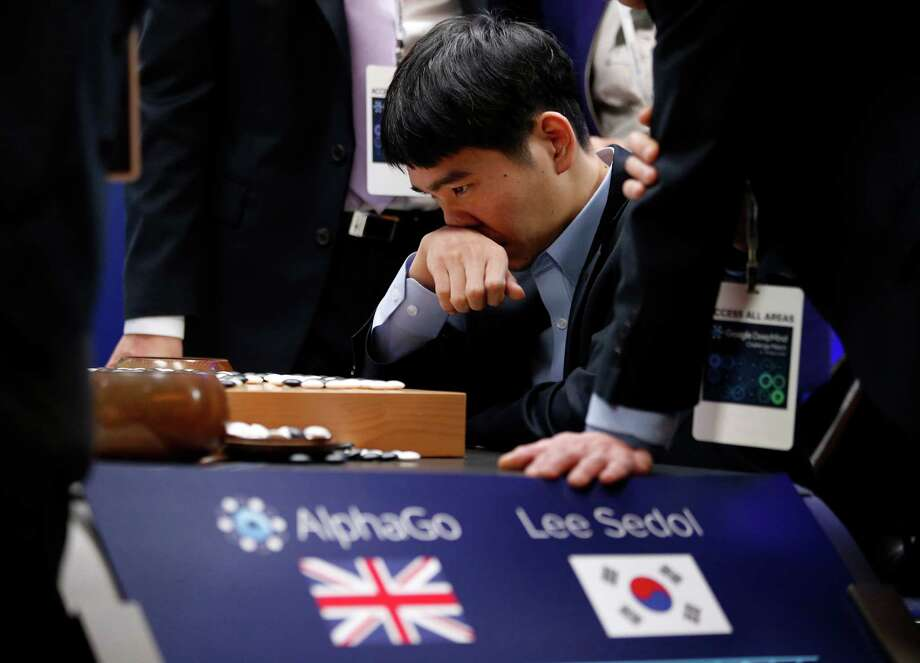 South Korean Go player Lee Sedol reviews the match Tuesday after finishing the final game of the challenge against Google's Go-playing program AlphaGo.  Photo: Lee Jin-man, STF / AP
