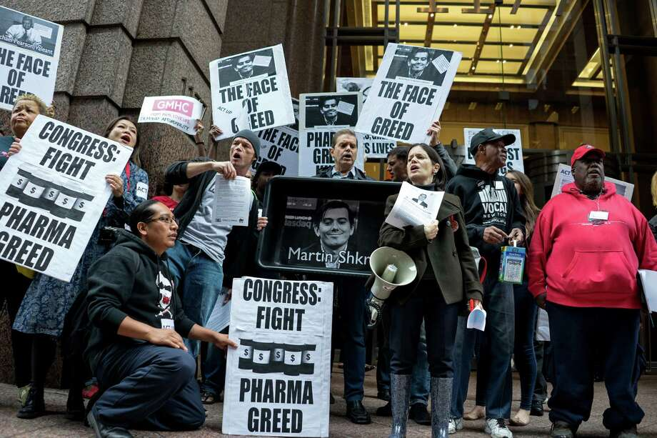 Activists hold signs containing the image of Turing Pharmaceuticals CEO Martin Shkreli in front the building that houses Turing's offices, during a protest in New York highlighting pharmaceutical drug pricing on Oct. 1, 2015. (AP Photo/Craig Ruttle, File) Photo: Craig Ruttle, FRE / FR61802 AP