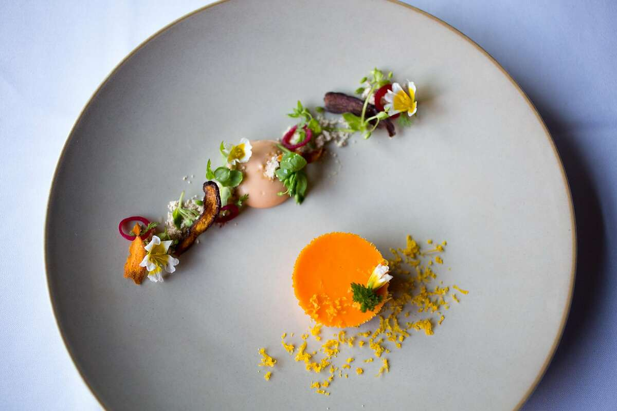 This is the carrot budino, roasted chicken spuma, cured egg yolk, and chick weed dish at Acquerello in San Francisco.