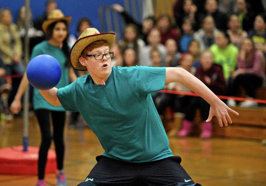 "Eighth grader Daniel Ramsey looks for a target during the annual ""Tiger Ball"" fundraiser for the Scotty Fund at Bethel Middle School on Tuesday afternoon, March 15, 2016, in Bethel, Conn. Ramsey is a team member of ""Manone's Cowboy's"" in the dodgeball tournament. Money raised from the event benefits the Scotty Fund which helps children in the Bethel area with life-threatening or critical illnesses Photo: H John Voorhees III / Hearst Connecticut Media / The News-Times"
