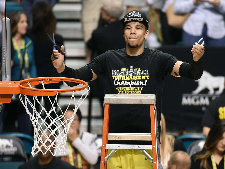 Oregon's Dillon Brooks cuts down the net after the Ducks assured their No. 1 seed by winning the Pac-12 tournament. Photo: Ethan Miller, Getty Images