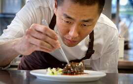 Chef Corey Lee prepares Sea Cucumber stuffed with Shrimp at Benu restaurant in San Francisco, Calif., on Friday, February 3, 2012.