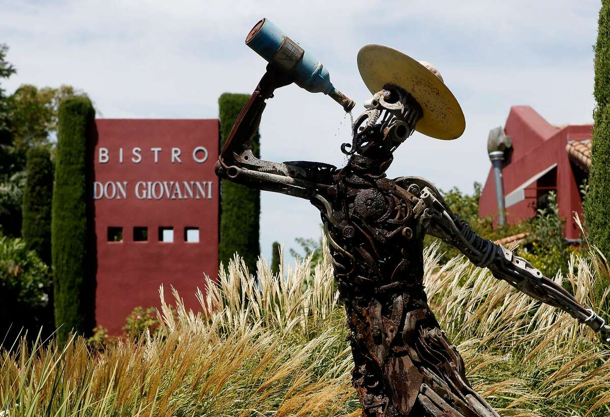 The humorous sign and statue of Bistro Don Giovanni just off highway 29. Various popular restaurants in Napa, Calif. including Bistro Don Giovanni, Angele, Morimoto Napa and eating places in the Oxbow Public Market.