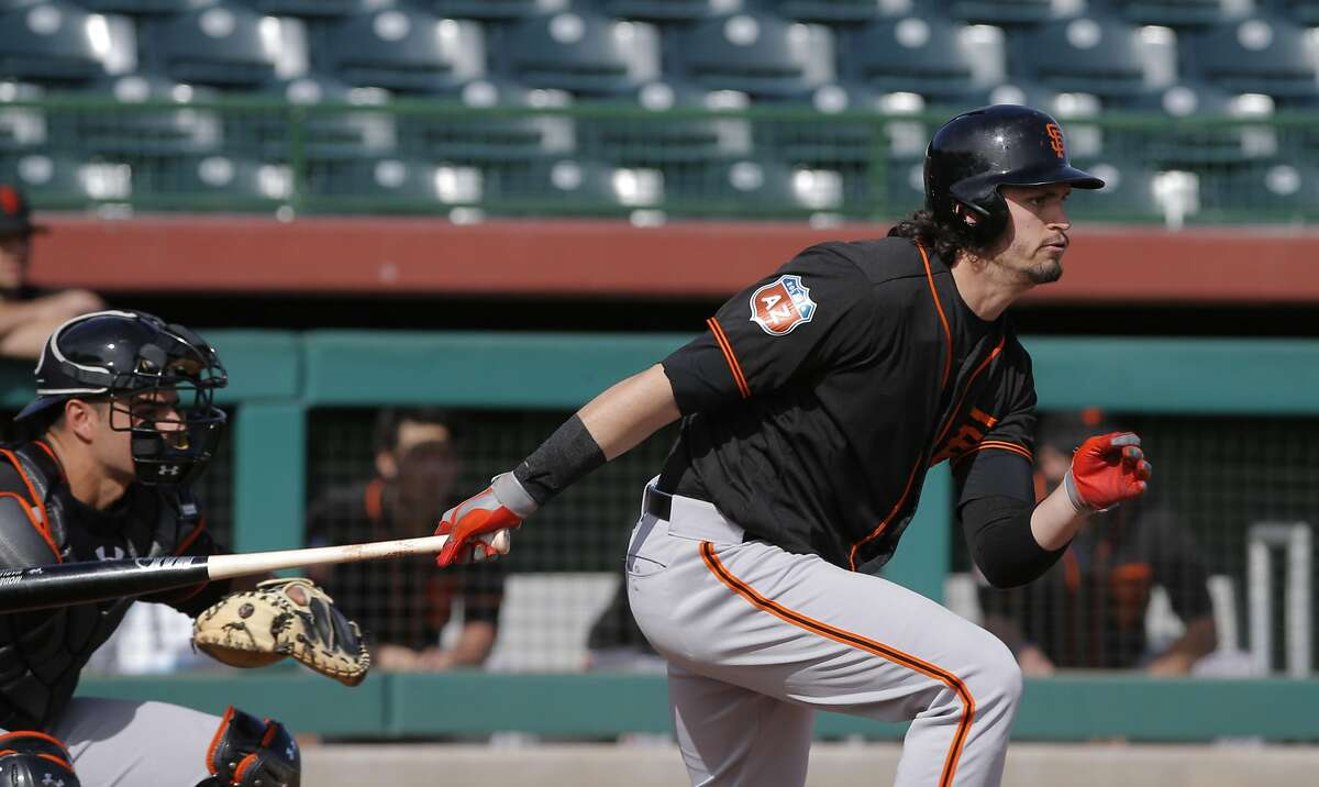 Jarrett Parker, 6 makes contact as the San Francisco Giants play an intrasquad game during spring training at Scottsdale Stadium on Tues. March 1, 2016, in Scottsdale, Arizona.
