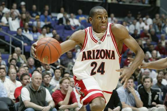 LOS ANGELES - MARCH 13:  Andre Iguodala #24 of Arizona drives against UCLA during the second half of the Pac-10 tournament game on March 13, 2003 at the Staples Center in Los Angeles, California.  UCLA defeated #1 ranked Arizona in overtime 96-89.  (Photo by Jeff Gross/Getty Images)