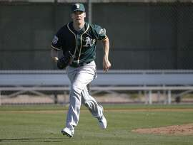 Pitcher Rich Hill, 18  runs drills during spring training workouts for the Oakland Athletics at the Lew Wolff Training Complex in Mesa, Arizona on Thurs. February 25, 2016.