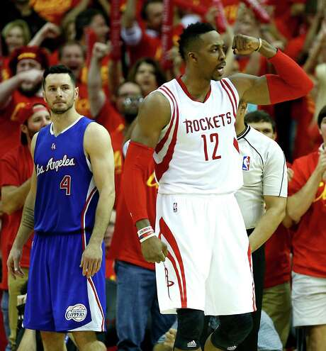 J.J. Redick, left, shows the disdain the Clippers hold for Dwight Howard and the Rockets after losing a seven-game playoff series last season. Photo: James Nielsen, Staff / © 2015  Houston Chronicle