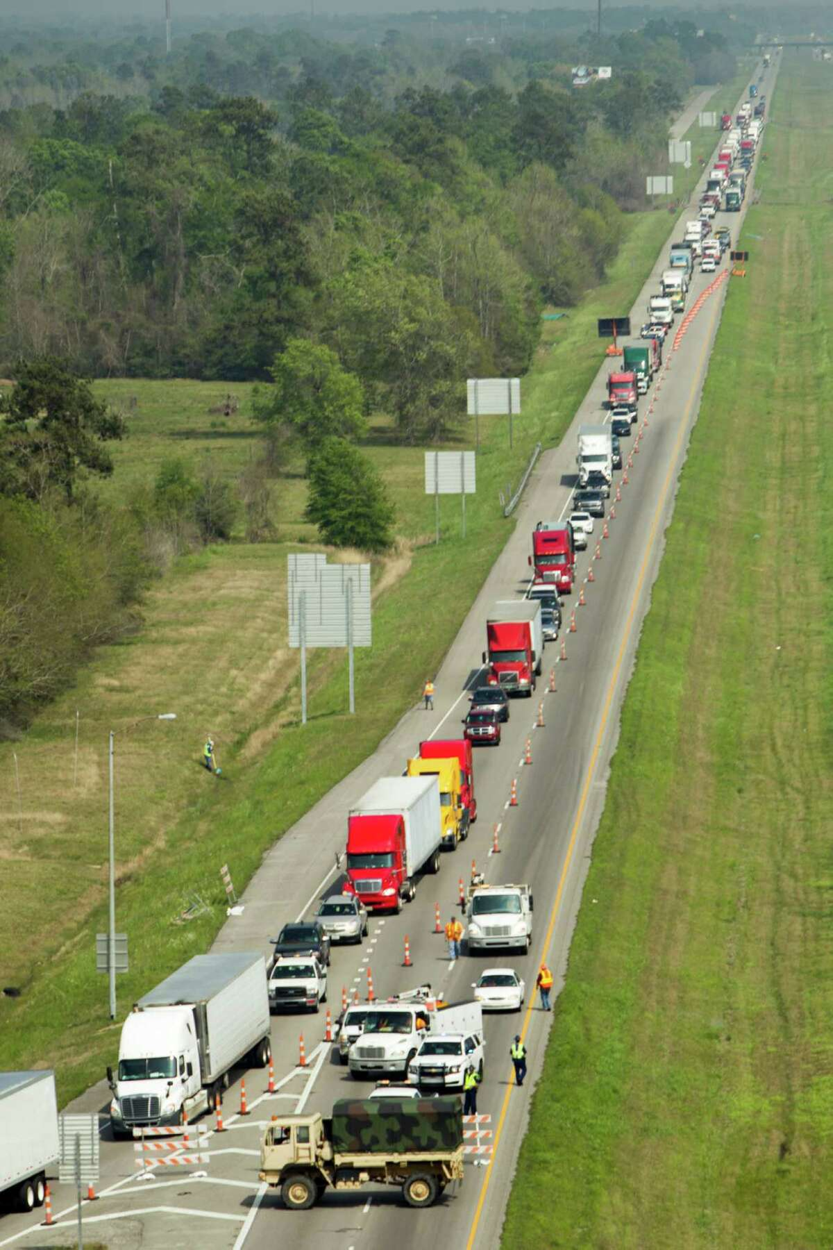 Traffic is diverted off of Interstate 10 in Vinton, La., as the highway was closed due to flood danger on Tuesday. Floodwaters stalled semis and backed up roads.