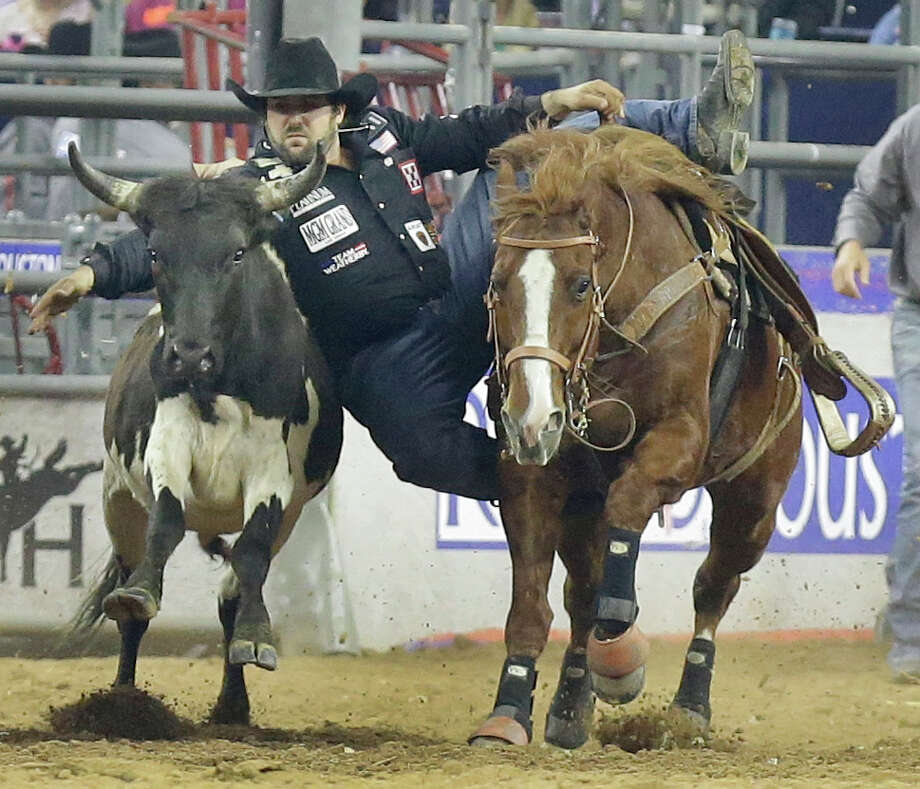 Luke Branquinho of Los Alamos, CA competes in steer wrestling at RodeoHouston during the Houston Livestock Show and Rodeo in NRG Stadium Tuesday, March 15, 2016, in Houston. Photo: Melissa Phillip, Houston Chronicle / © 2016 Houston Chronicle
