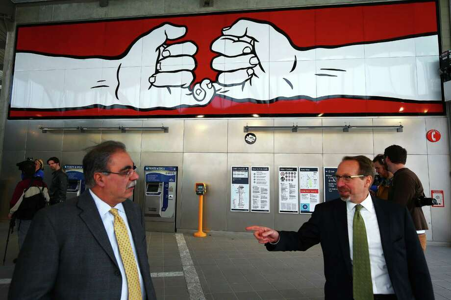 CEO of Sound Transit Peter Rogoff, right, and Ahmad Fazel, executive director of design and construction for Sound Transit, talk inside the new Capitol Hill light rail station during a Sound Transit-hosted first-look ride for the media from the University of Washington station to the Capitol Hill station, Tuesday, March 15, 2016.  Both stations will begin train service Saturday at 10 a.m. Photo: GENNA MARTIN, SEATTLEPI.COM / SEATTLEPI.COM