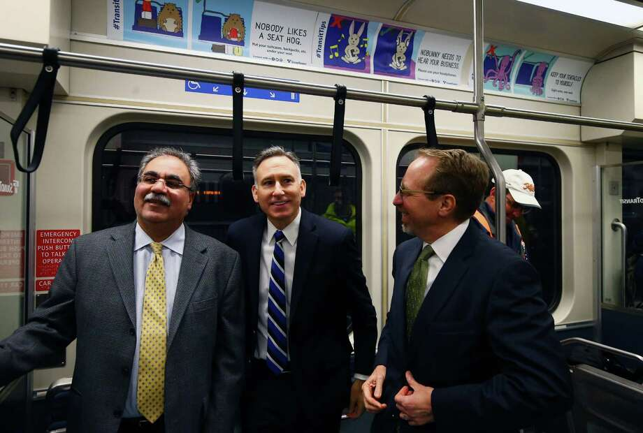 (from left) Sound Transit executive director of design and construction Ahmad Fazel, King County Executive and Sound Transit board chair Dow Constantine, and Sound Transit CEO Peter Rogoff ride the light rail from the new Capitol Hill station to the new University of Washington station. Photo: GENNA MARTIN, SEATTLEPI.COM / SEATTLEPI.COM