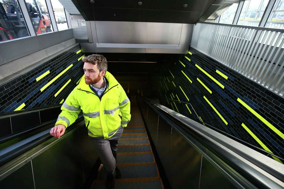 Peter Brown, principle construction manager of the University of Washington light rail station project, rides the escalator up from the new station during a Sound Transit-hosted first-look ride from the University of Washington station to the Capitol Hill station, Tuesday, March 15, 2016. Both stations will begin train service Saturday at 10 a.m.