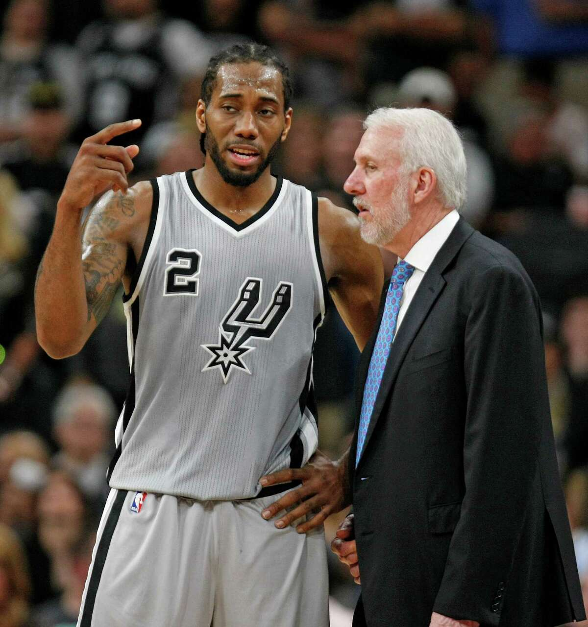 SAN ANTONIO,TX - MARCH 12: Kawhi Leonard #2 of the San Antonio Spurs talks with head coach Gregg Popovich at AT&T Center on March 12, 2016 in San Antonio, Texas. NOTE TO USER: User expressly acknowledges and agrees that , by downloading and or using this photograph, User is consenting to the terms and conditions of the Getty Images License Agreement.