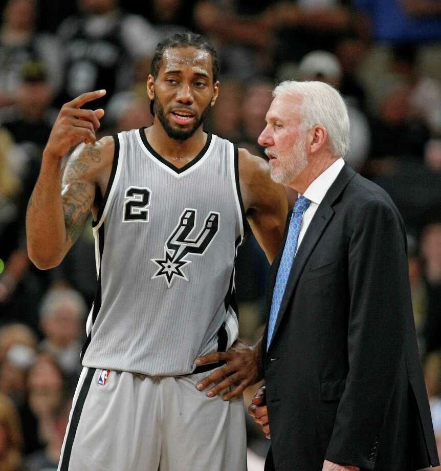 SAN ANTONIO,TX - MARCH 12: Kawhi Leonard #2 of the San Antonio Spurs talks with head coach Gregg Popovich at AT&T Center on March 12, 2016 in San Antonio, Texas.  NOTE TO USER: User expressly acknowledges and agrees that , by downloading and or using this photograph, User is consenting to the terms and conditions of the Getty Images License Agreement. Photo: Ronald Cortes, Getty Images / 2016 Getty Images