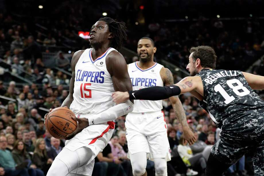 Los Angeles Clippers forward Johnathan Motley (15) is fouled by San Antonio Spurs guard Marco Belinelli (18) while driving to the basket during the first half of an NBA basketball game, Sunday, Jan. 20, 2019, in San Antonio. (AP Photo/Eric Gay) Photo: Eric Gay, Associated Press / Copyright 2019 The Associated Press. All rights reserved.