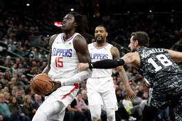 San Antonio Spurs guard DeMar DeRozan (10) drives into Los Angeles Clippers guard Avery Bradley (11) during the first half of an NBA basketball game, Thursday, Dec. 13, 2018, in San Antonio. (AP Photo/Eric Gay)