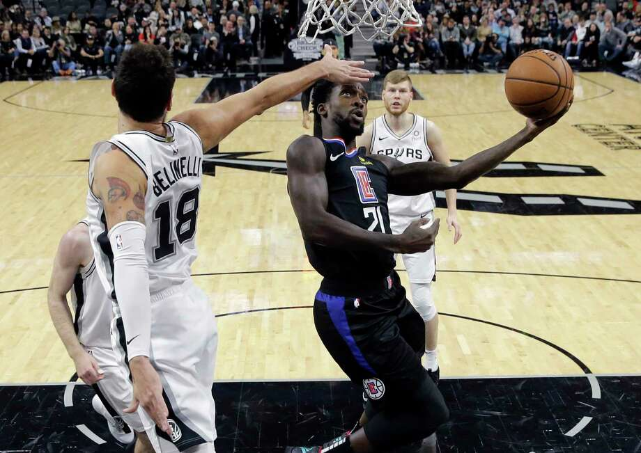 Los Angeles Clippers center DeAndre Jordan (6) is fouled as he attempts to drive between San Antonio Spurs' LaMarcus Aldridge, left, and Rudy Gay during the first half of an NBA basketball game, Monday, Dec. 18, 2017, in San Antonio. (AP Photo/Darren Abate) Photo: Darren Abate, Associated Press / FR115 AP