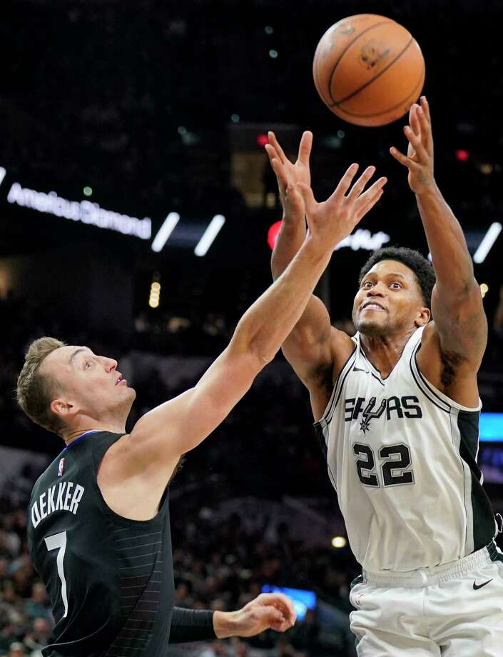 Los Angeles Clippers forward Sam Dekker (7) grabs for the rebound against San Antonio Spurs forward Rudy Gay during the first half of an NBA basketball game, Monday, Dec. 18, 2017, in San Antonio. (AP Photo/Darren Abate) Photo: Darren Abate, Associated Press / FR115 AP