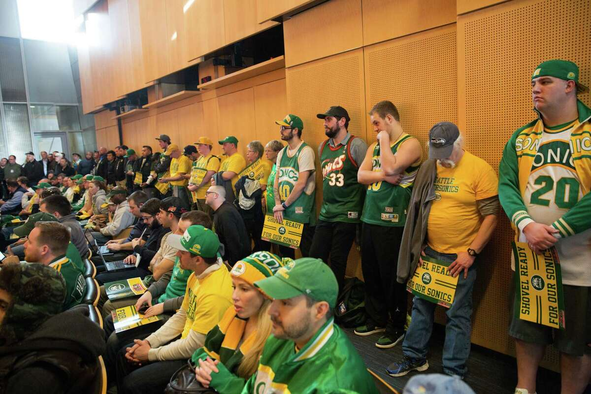 Numerous SuperSonic fans find standing-room-only in the city council chambers to show their support for a new Seattle SuperSonics arena in SoDo, at Seattle City Hall on Tuesday, Mar. 15, 2016.