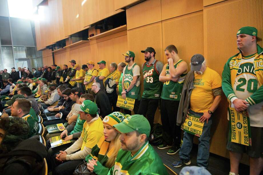 Numerous SuperSonic fans find standing-room-only in the city council chambers to show their support for a new Seattle SuperSonics arena in SoDo, at Seattle City Hall on Tuesday, Mar. 15, 2016. Photo: GRANT HINDSLEY, SEATTLEPI.COM / SEATTLEPI.COM