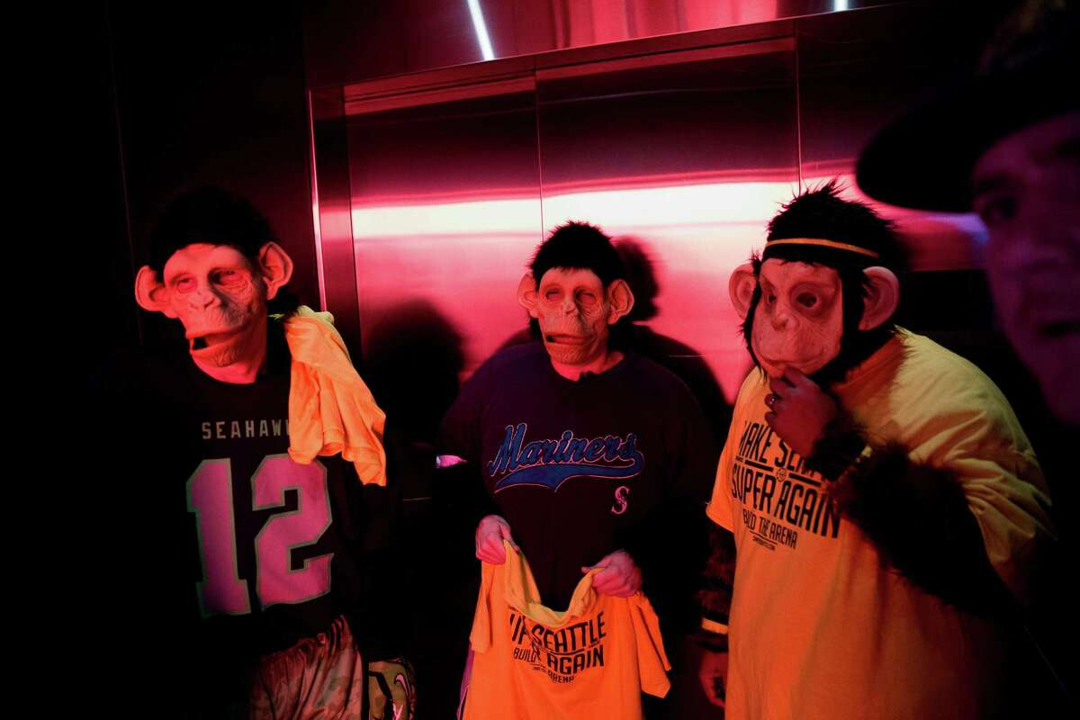 Seattle SuperSonics fans wearing gorilla masks ride the elevator to a fan event before a hearing on the proposed new arena in SoDo, at Seattle City Hall on Tuesday, Mar. 15, 2016.