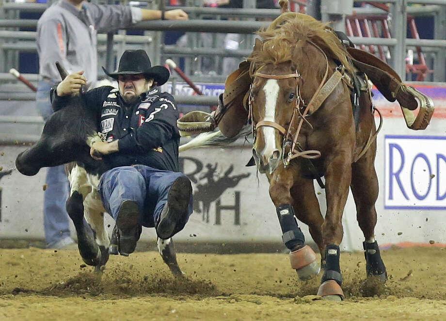 Luke Branquinho shows world champion steer wrestling form Tuesday night. Photo: Melissa Phillip, Staff / © 2016 Houston Chronicle