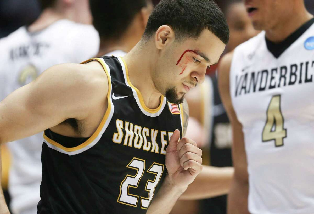 Wichita State's Fred VanVleet is bloodied after taking an elbow to the face from Vanderbilt forward Jeff Roberson during the first half in the opening round of the NCAA Tournament at UD Arena in Dayton, Ohio, on Tuesday, March 15, 2016.