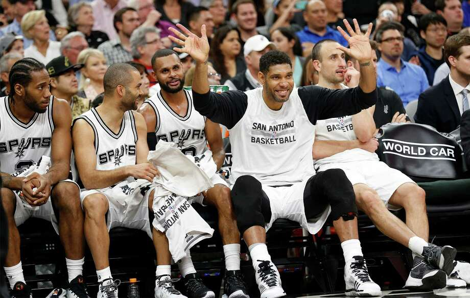 Spurs' Tim Duncan (21) has a little fun on the bench as the Spurs pulled away from the Los Angeles Clippers at the AT&T Center on Tuesday, Mar. 15, 2016. Spurs defeated the Clippers 108-87. (Kin Man Hui/San Antonio Express-News) Photo: Kin Man Hui, Staff / San Antonio Express-News / ©2016 San Antonio Express-News