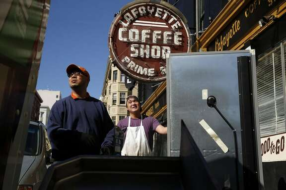 Stanley Yang (left) and Gene Yang (right) prepare to load a cooler onto a truck after Stanley Yang lost the lease to the storefront where he ran Lafayette Coffee Shop on Hyde Street in San Francisco, Calif., on Tuesday, March 15, 2016.