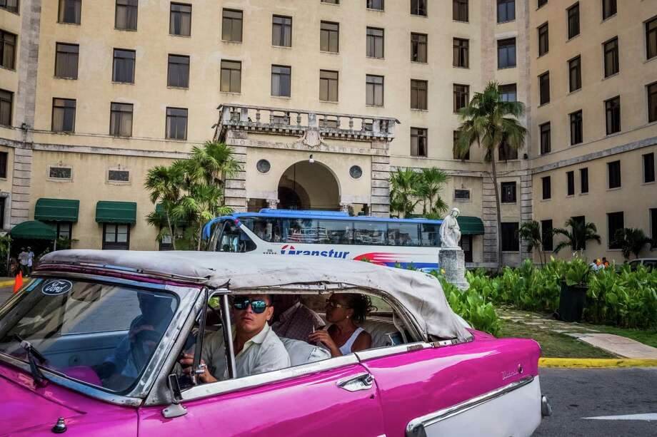 Near the Hotel Nacional De Cuba is one of Havana's iconic 1950s American cars. Under Tuesday's changes, Americans who plan trips with full schedules of educational exchange activities will for the first time in many years be able to travel on their own to Cuba. Photo: DANIEL BEREHULAK, STR / NYTNS
