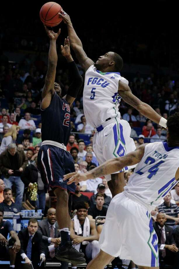 Florida Gulf Coast's Zach Johnson (5) blocks a shot by Fairleigh Dickinson's Darian Anderson (2) in the second half of a First Four game of the NCAA college basketball tournament, Tuesday, March 15, 2016, in Dayton, Ohio. (AP Photo/John Minchillo) Photo: John Minchillo, STF / AP