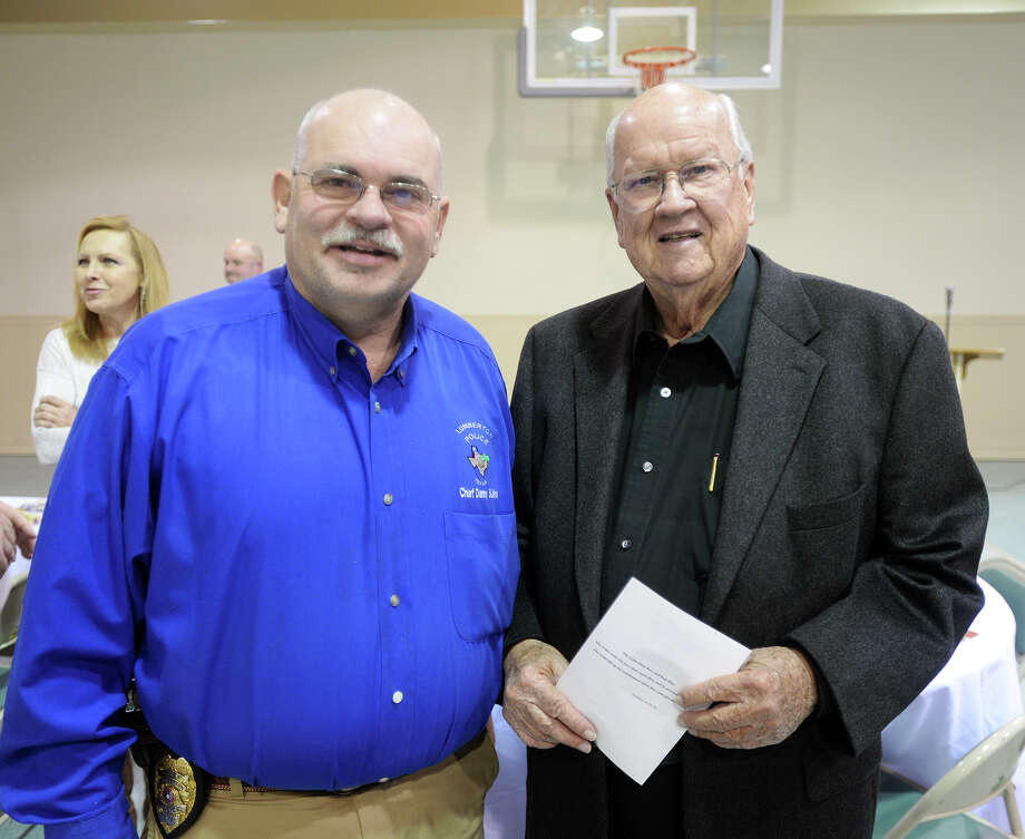 Danny Sullins, left, and Reverend Charles Duplissey pose for a photo Thursday evening. The First Pentecostal Church of Silsbee hosted an appreciation banquet for members of law enforcement at all levels Thursday night. Pastor Homer Looper said the church expected about 150 people to attend. Photo taken Thursday 1/15/15 Jake Daniels/The Enterprise Photo: Jake Daniels / ©2014 The Beaumont Enterprise/Jake Daniels
