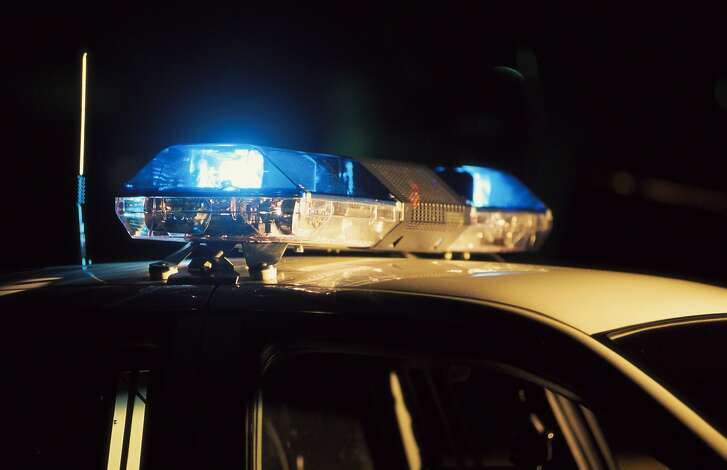 File photo of police squad car at night.  Patrol car with lights flashing