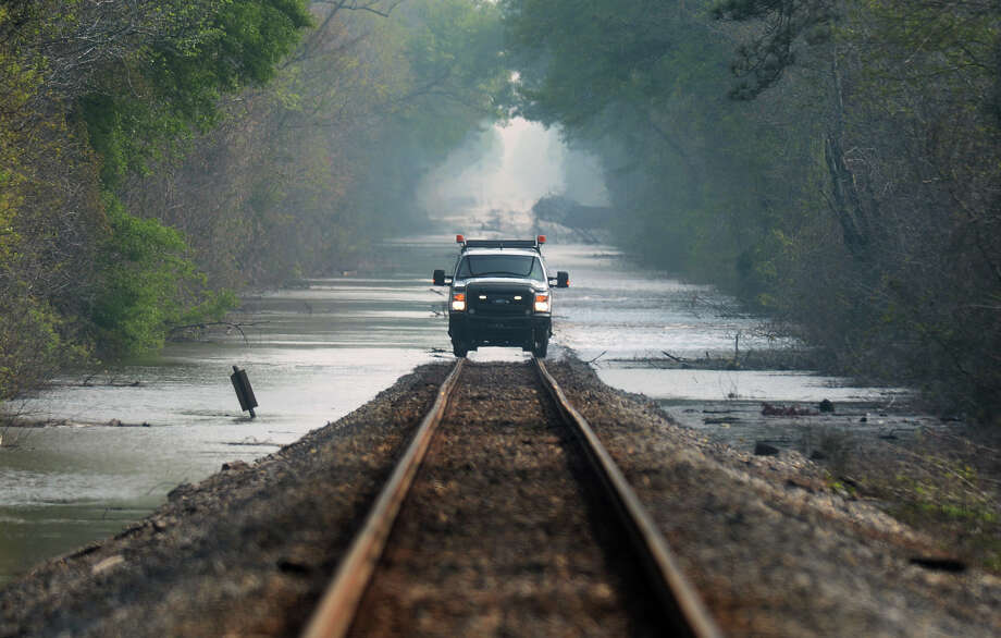 A truck drives along past flooded railroad tracks near Hartburg Road south of Deweyville.   Photo taken Tuesday, March 15, 2016 Guiseppe Barranco/The Enterprise Photo: Guiseppe Barranco, Photo Editor