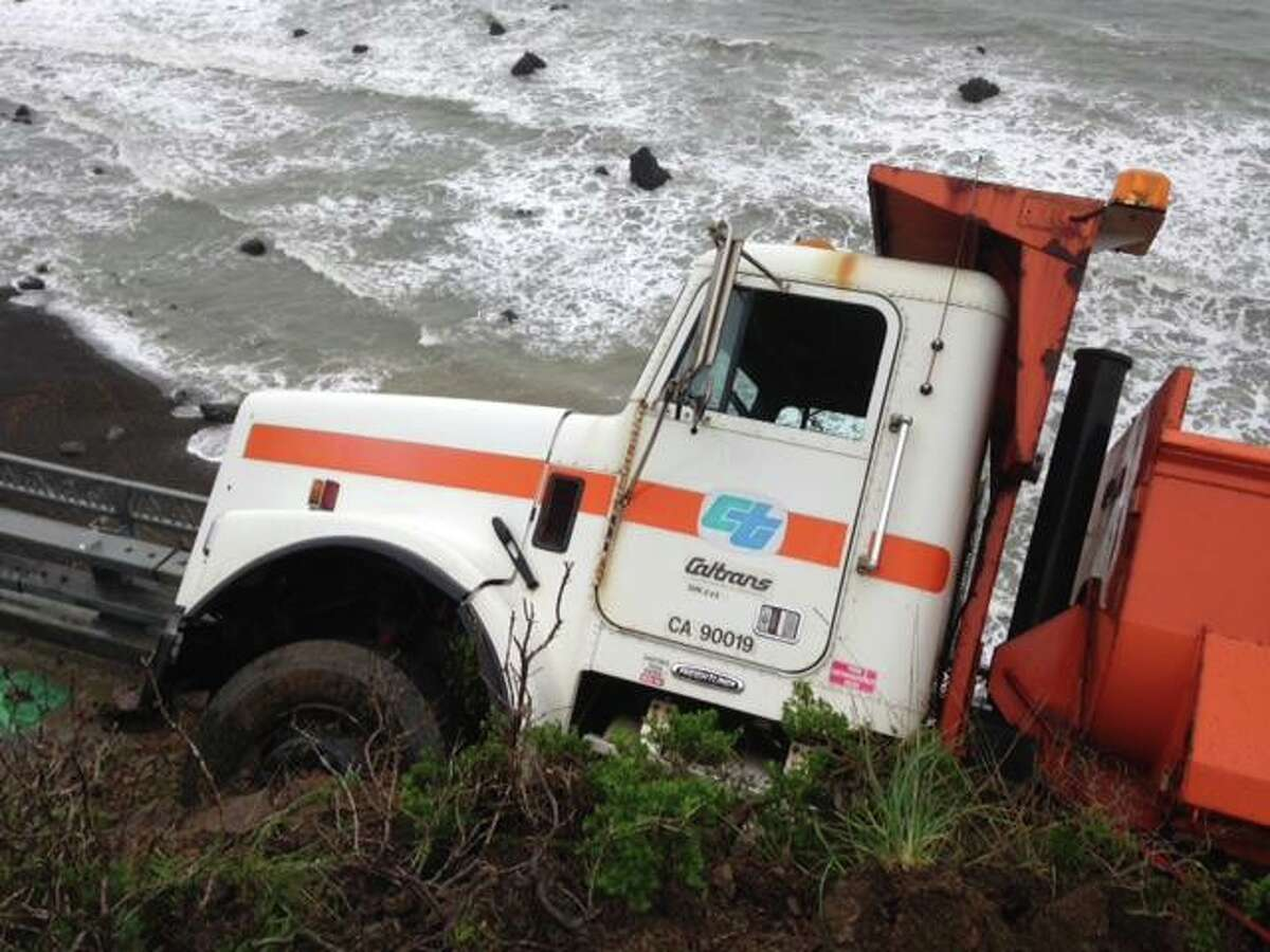 A Caltrans employee and his dump truck were hit by a mudslide on Highway 1 in Mendocino while responding to a earlier mudslide north of Westport on March 11, 2016.