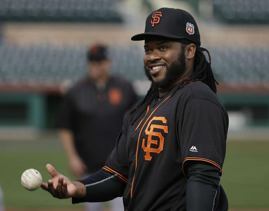 San Francisco Giants pitcher Johnny Cueto throws a ball to a fan during practice before the spring baseball season in Scottsdale, Ariz., Thursday, Feb. 18, 2016. (AP Photo/Chris Carlson) Photo: Chris Carlson, Associated Press
