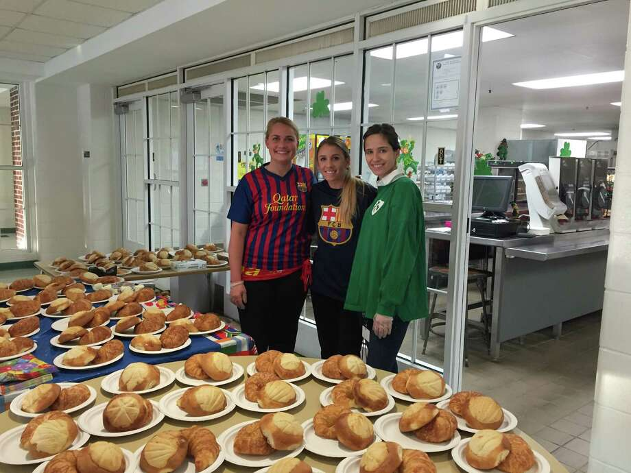 "Middlesex Middle School held a ""World Language Breakfast"" for students to enjoy as close to an authentic breakfast as possible from a French-speaking or Spanish-speaking country.  A hot chocolate and pastry is a common breakfast in those countries. A croissant with butter and jam was the French option and the pan dulce was the Latin American option. Sporting international jerseys are teachers Marisa Keen, Michelle McCormack and Lauren Pournaras. Photo: Darien News / Contributed Photo / Darien News"