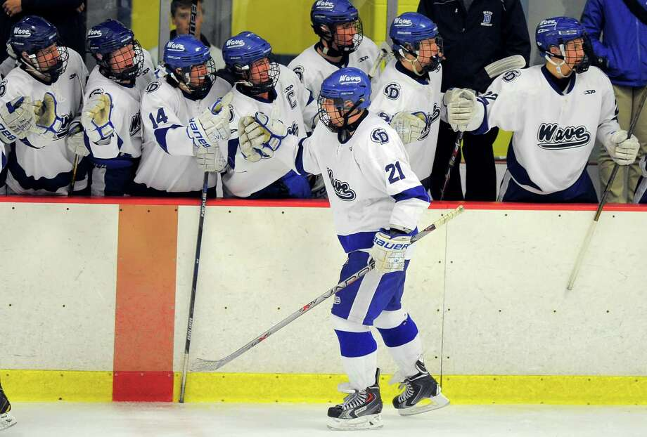 Darien's Max Romeyn (21) celebrates his third-period, game-winning goal against New Canaan in a CIAC Division 1 playoff game at Terry Conners Ice Rink in Stamford on Wednesday. Darien defeated New Canaan 3-2. Photo: Matthew Brown / Hearst Connecticut Media / Stamford Advocate