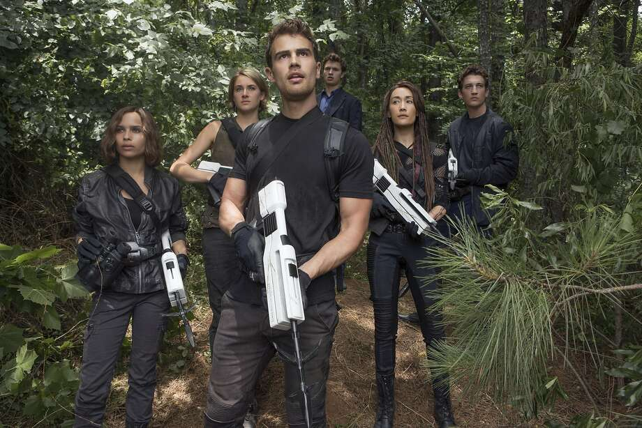 "This image released by Lionsgate shows from left, Zoe Kravitz, Shailene Woodley, Theo James, Ansel Elgort, Maggie Q and Miles Teller in a scene from ""The Divergent Series: Allegiant."" (Murray Close/Lionsgate via AP) Photo: Murray Close, AP"