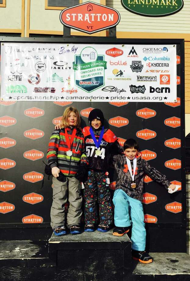 Sumner Orr (left) on the winner's podium at a boarder cross event at Stratton Mountain. Photo: Contributed / Contributed