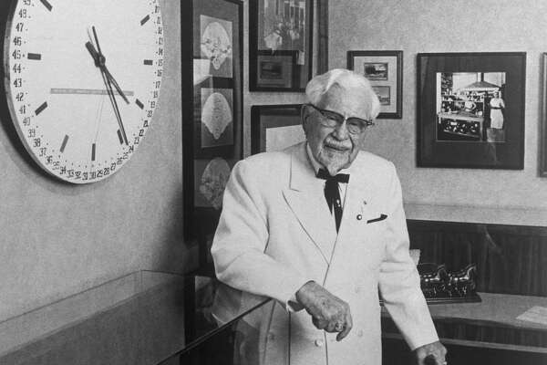 Colonel Harland Sanders, the founder of Kentucky Fried Chicken, is shown here as he celebrates his 88th birthday.