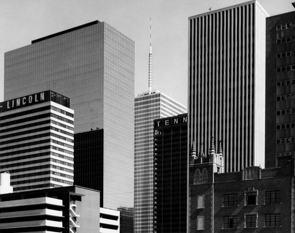 From the March 26, 1972, Houston Chronicle: Trim straight lines of newer downtown buildings form a contrasting background for the spires atop the First Methodist Church Building, lower right. The newer buildings, towering above the older structure are left to right: The Sheraton-Lincoln, the United Gas Building, One Shell Plaza, Tenneco Building, the Houston Natural Gas Building and part of the Capitol National Bank Building. The angle from which the picture was taken makes the One Shell Plaza Building, topped by the antenna, appear smaller than some of the other structures. The building, in fact, towers 50 stories high and is the tallest in the city. The Tenneco Building, too, is reduced in size by the camera angle.