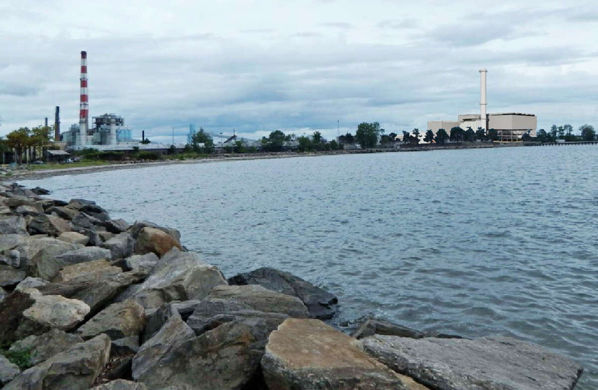 This composite photo shows the new gas-burning power plant with a 300-foot smokestack to the right of the existing smokestack as viewed from Seaside Park in Bridgeport, Conn.