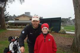 Three-time major champion Padraig Harrington poses with Daniel Connolly, then 10, after they were part of a group playing at Harding Park in February 2008. Connolly, now 18, won the San Francisco City Championship at Harding on Sunday.