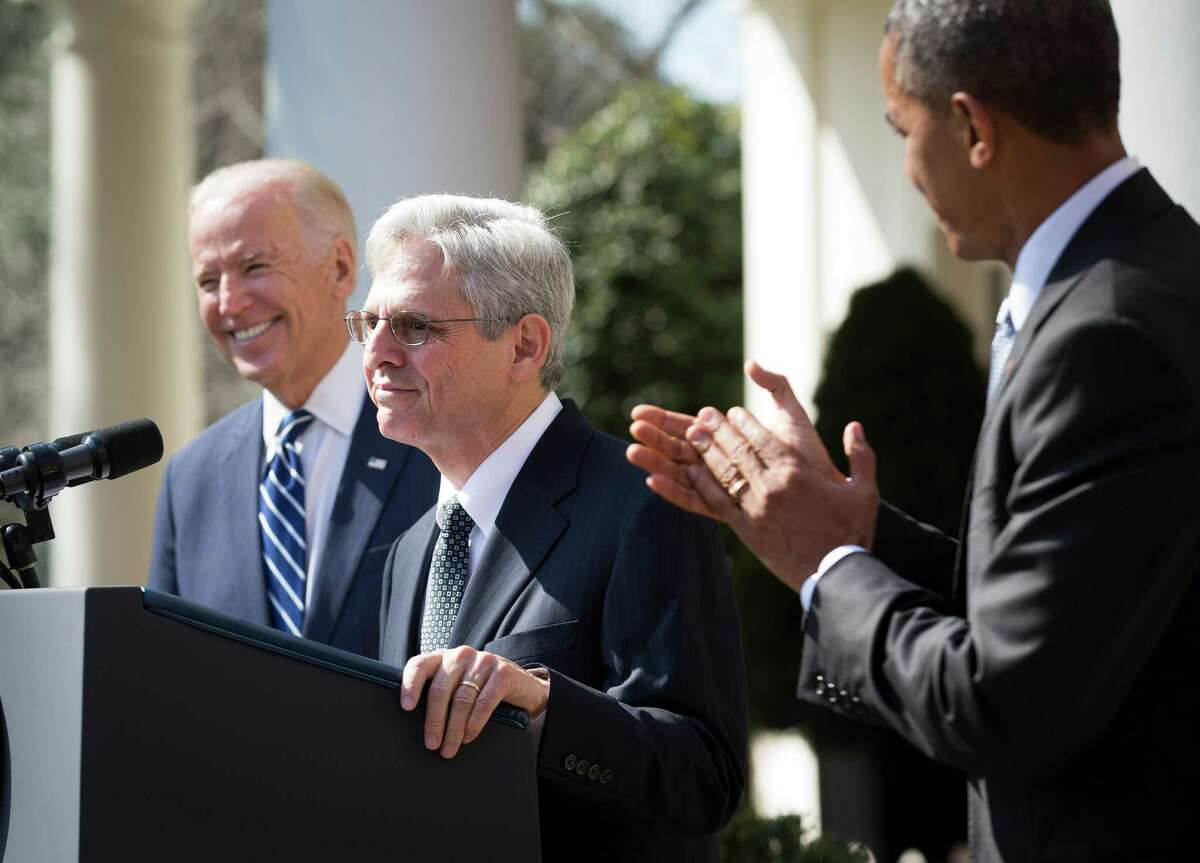 President Barack Obama and Vice President Joe Biden look on as Obama's nominee for the Supreme Court vacancy Merrick Garland, currently chief judge for U.S. Court of Appeals D.C. Circuit, speaks during the announcement in the Rose Garden at the White House in Washington, March 16, 2016. (Doug Mills/The New York Times)