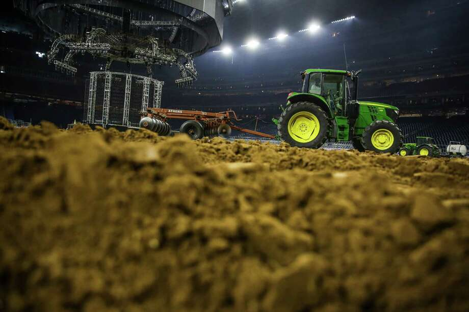 A tractor pulls a disc through the dirt at NRG Stadium in preparation for the rodeo Tuesday. Photo: Michael Ciaglo, Houston Chronicle / © 2016  Houston Chronicle